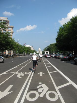 Richmond area visitors enjoying the buffered bike lane down the center of Pennsylvania Avenue in D.C. during a informational visit organized by Bike Walk RVA last spring.