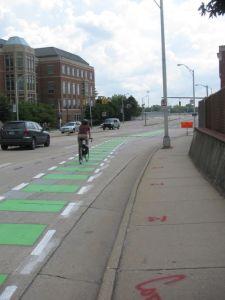 Green markings highlight the emerging bike lane on Leigh Street near VCU Medical Center.