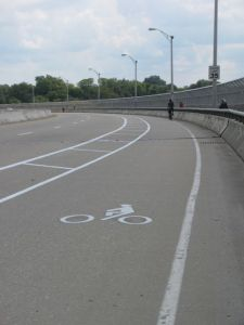 Bike lane with a roughly four-foot buffer on the south side of the MLK Bridge.