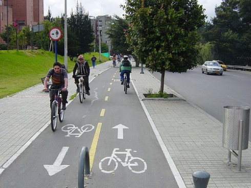 Protected bike lane (cycle track) in Bogota, Colombia.  From https://cbuscyclechic.wordpress.com.